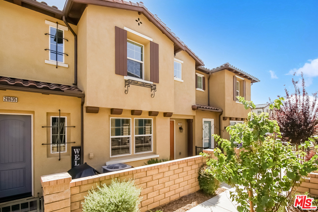 Built in 2019, this Valencia two-story home offers granite countertops, and a two-car garage.