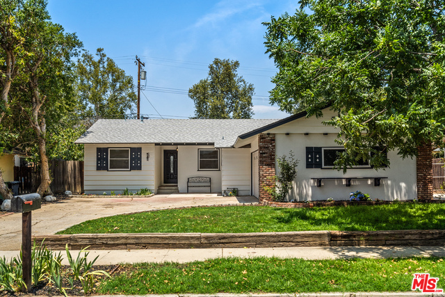 Located on a quiet, tree lined street in Central Simi Valley, this newly updated home is move-in ready! This three bedroom, two bathroom home features a fully updated main bathroom, and an ensuite bath off of the third bedroom. Interior updates were completed in 2021 and include a brand new kitchen with LG stainless steel appliances, granite counter tops and soft close cabinetry. Throughout the house you'll find beautiful vinyl flooring, recessed lighting, central AC and heat, and updated windows.  A full size laundry room off of the kitchen allows for side-by-side washer and dryer.  Outside boasts new paint, landscaping with sprinkler/drip system, fresh grass and colorful flowers. There's also a cozy brick patio to sit and enjoy the large backyard. A spacious 2 car garage has been finished with new drywall and houses the tankless water heater. Other updates include a newer roof and copper plumbing. All this is close to shopping, restaurants, schools, parks and theaters. Take advantage of this opportunity to make this beautiful house your new home! It's certain to go quickly!