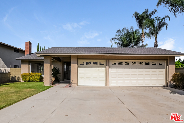 This Simi Valley one-story home offers a patio, granite countertops, and a three-car garage. This home has been virtually staged to illustrate its potential.