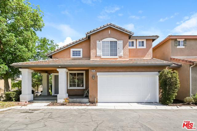 This Simi Valley two-story cul-de-sac home offers a patio, and a two-car garage.